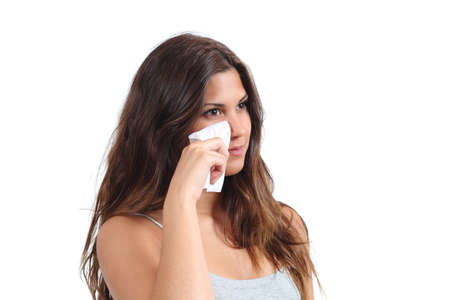 removing make up: Attractive woman cleaning her face with a baby wipe isolated on a white background                Stock Photo