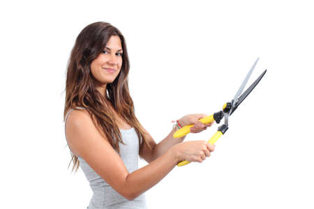 Beautiful woman holding a pruning shears isolated on a white background                photo