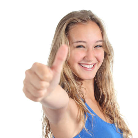 Close up of a beautiful teenage girl with thumb up isolated on a white background photo