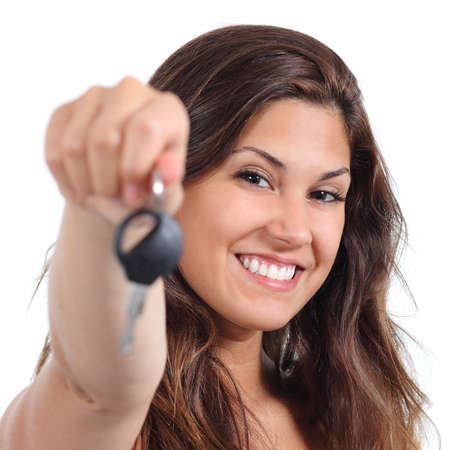 Beautiful woman smiling and holding her car key isolated on a white background