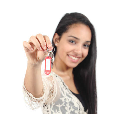 Beautiful casual muslim woman holding a house keys isolated on a white background           photo