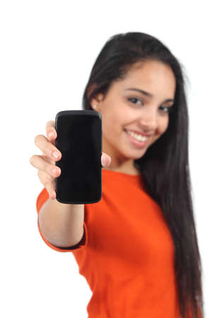 Beautiful casual muslim woman showing a blank smartphone screen isolated on a white background          Stock Photo