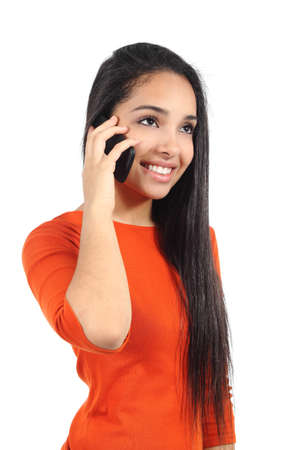 telephony: Beautiful and happy casual muslim woman talking on the mobile phone isolated on a white background