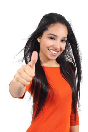 Happy beautiful muslim teenager girl with thumb up isolated on a white background                photo