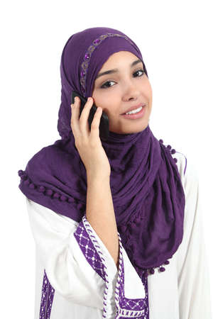Beautiful arab woman wearing a hijab on the phone isolated on a white background                 photo