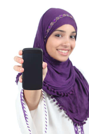 exhibiting: Arab woman with a hijab showing a blank smartphone screen isolated on a white background