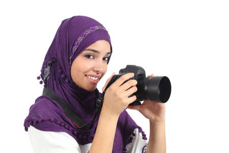 Arab woman wearing a hijab taking a photography with a slr camera isolated on a white background          Stock Photo