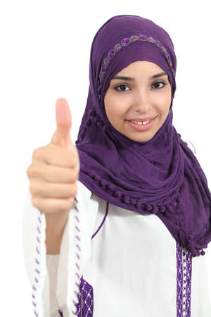 islamic wonderful: Beautiful and happy arabian woman wearing a hijab with thumb up isolated on a white background