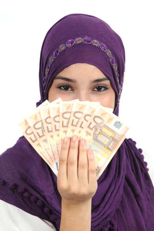 Muslim woman wearing a hijab holding a lot of money isolated on a white background      photo