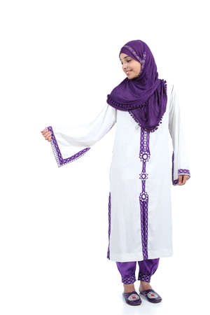 Standing arab woman posing wearing a hijab isolated on a white background              photo