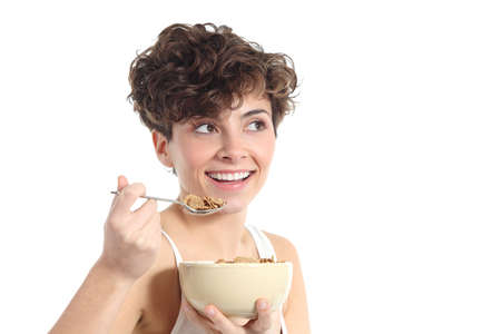 Fashion woman eating corn flakes isolated on a white background               Stock Photo - 21089767