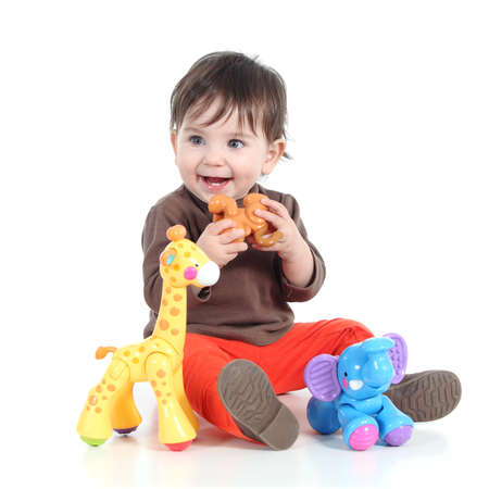 babies with toys: Pretty little baby girl playing with animal toys isolated on a white background