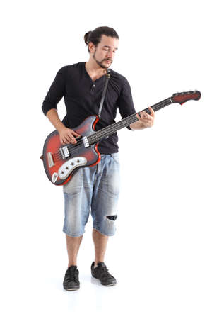 Boy playing bass isolated on a white background        photo