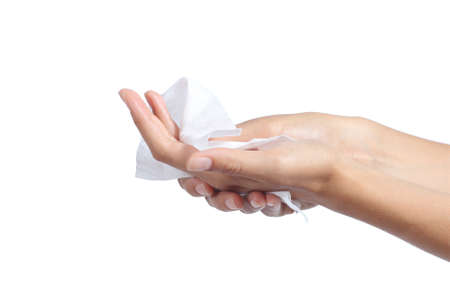 wiping: Woman cleaning her hands with a tissue isolated on a white background             Stock Photo