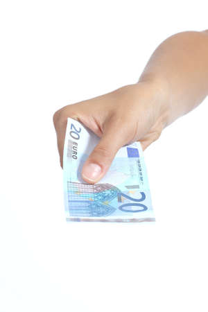 20 euro: Woman hand giving a twenty euros banknote isolated on a white background