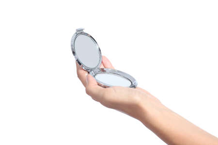 hand mirror: Woman hand holding a hand mirror isolated on a white background