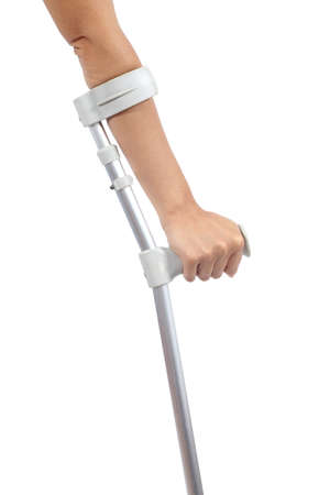 limp: Woman hand using a crutch isolated on a white background