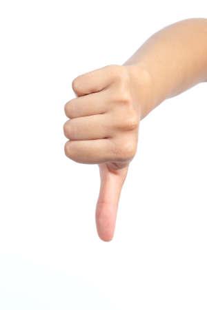 disapproving: Mano della donna con il pollice verso il basso isolato su uno sfondo bianco