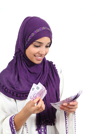 Beautiful arab woman counting a lot of five hundred euros banknotes isolated on a white background                 Stock Photo - 21275474