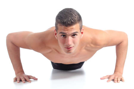 Front view of a man doing pushups isolated on a white background photo