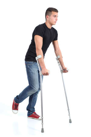 Man walking with crutches isolated on a white background