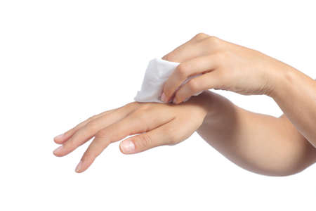 wipe: Hands of a woman cleaning with a baby wipe isolated on a white background               Stock Photo