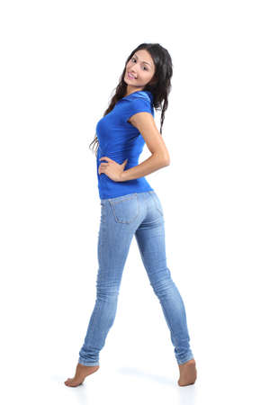 Beautiful woman posing with jeans isolated on a white background