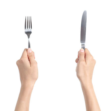 holding a knife: Woman hands holding a fork and a knife isolated on a white background