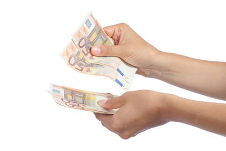 Woman hands holding and counting a lot of fifty euros banknotes isolated on a white background Stock Photo - 21465564