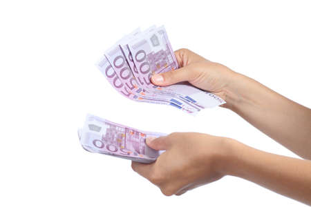 Woman hands holding and counting a lot of five hundred euros banknotes isolated on a white background Stock Photo - 21465565