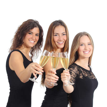 three wishes: Beautiful group of three women toasting with champagne isolated on a white background