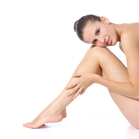 waxed legs: Beautiful perfect woman posing with long legs isolated on a white background                  Stock Photo