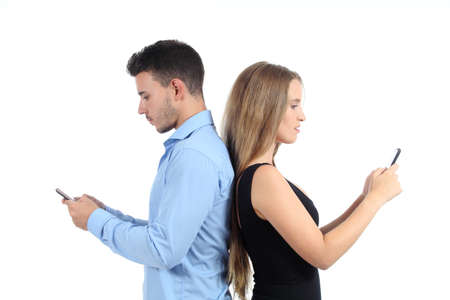 Attractive couple typing in their mobile phones isolated on a white background Stock Photo - 22038079