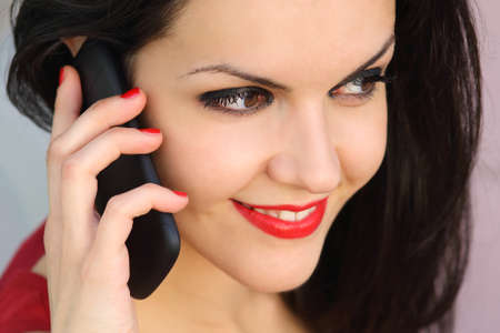 Close up of a beautiful woman face on the phone outdoor photo