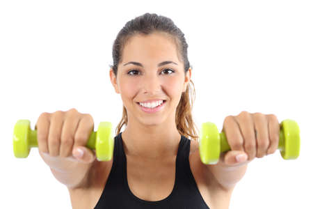 Front view of a beautiful sportswoman practicing aerobic with dumbbells isolated on a white background photo
