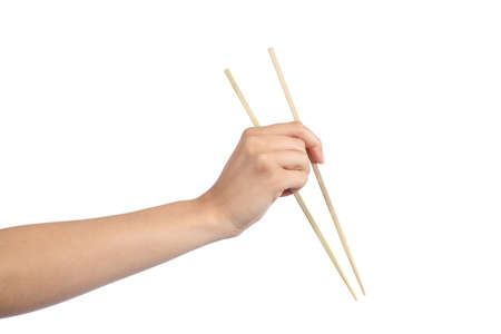 Woman hand using a chopsticks isolated on a white background            photo