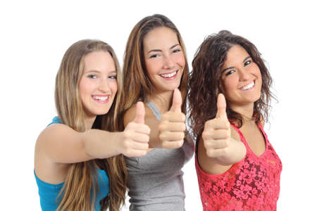 Group of three girls with thumb up isolated on a white background photo