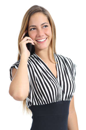 Beautiful elegant woman wearing a dress talking on the mobile phone isolated on a white background photo