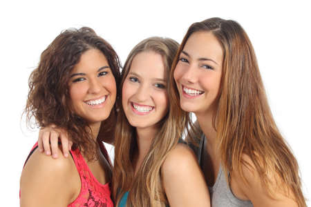 Group of three women laughing and looking at camera isolated on a white background photo