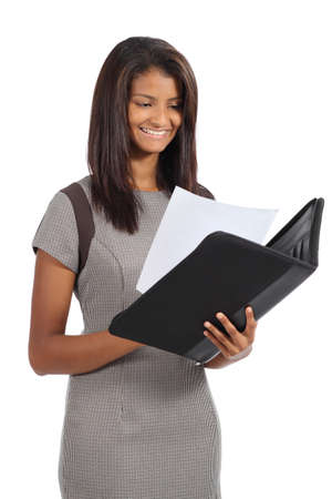 south american ethnicity: Beautiful african american businesswoman reading a report isolated on a white background