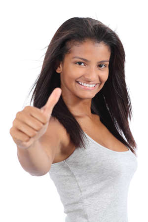 Beautiful colombian teenager girl gesturing thumb up isolated on a white background photo