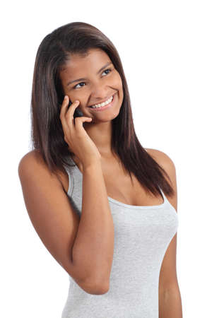 Beautiful african american girl on the phone isolated on a white background photo