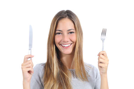 Beautiful woman holding a fork and a table knife isolated on a white background                 photo