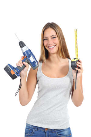 Beautiful woman holding a power drill and a tape measure isolated on a white background                 photo