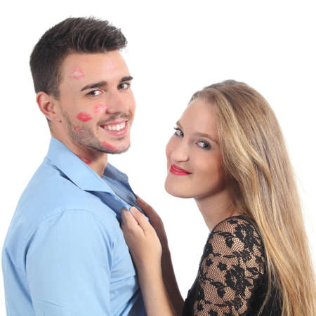 seducing: Woman grabbing a man with a lot of lipstick shapes isolated on a white background