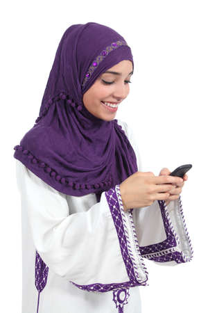 send sms: Beautiful arab woman browsing her smart phone isolated on a white background             Stock Photo