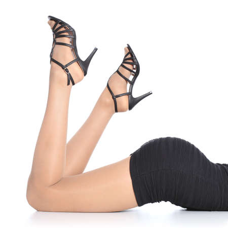 Beautiful woman legs with stockings and heels pointing up isolated on a white background              photo