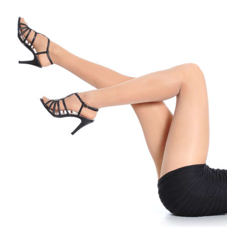 Woman legs with stockings and heels pointing up isolated on a white background             photo