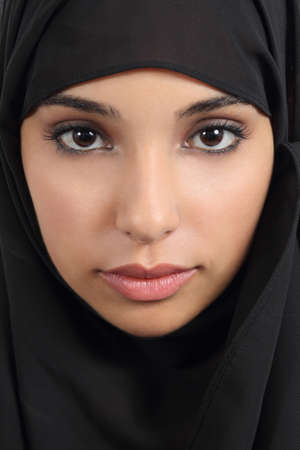 Portrait of a front view of a beautiful arab woman face with a black scarf      Stok Fotoğraf