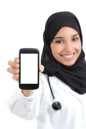 Beautiful arab female doctor showing a blank smart phone screen  photo